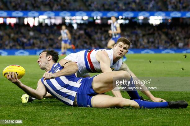 Todd Goldstein of the Kangaroos handballs during the round 21 AFL match between the North Melbourne Kangaroos and the Western Bulldogs at Etihad...