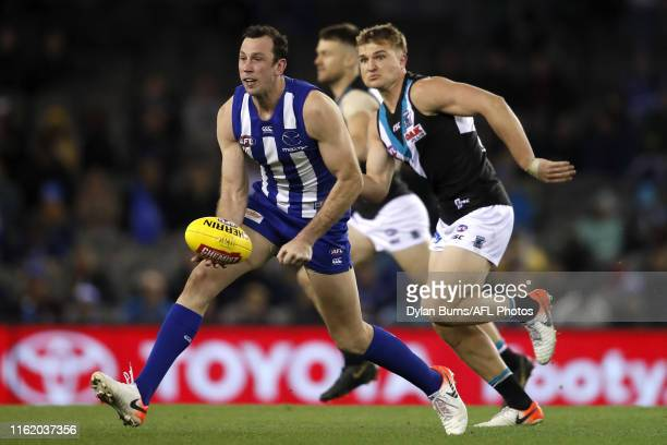 Todd Goldstein of the Kangaroos handpasses the ball during the 2019 AFL round 22 match between the North Melbourne Kangaroos and the Port Adelaide...