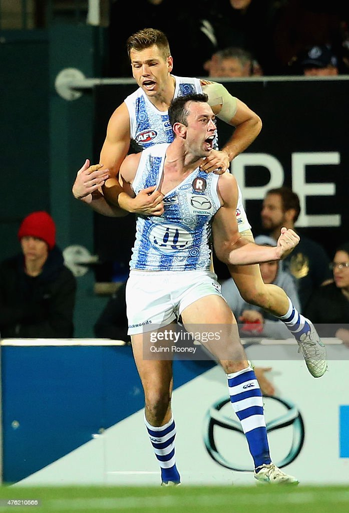 Todd Goldstein of the Kangaroos is congratulated by Shaun Higgins after kicking a goal during the round 10 AFL match between the North Melbourne Kangaroos and the West Coast Eagles at Blundstone Arena on June 7, 2015 in Hobart, Australia.