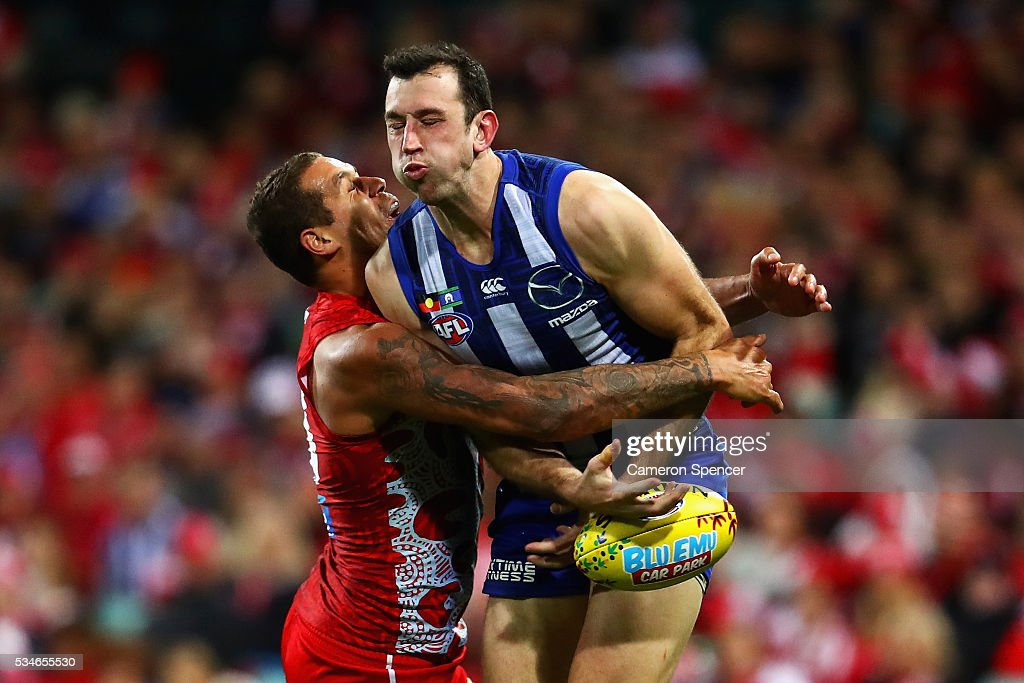 Todd Goldstein of the Kangaroos is tackled by Lance Franklin of the Swans during the round 10 AFL match between the Sydney Swans and the North Melbourne Kangaroos at Sydney Cricket Ground on May 27, 2016 in Sydney, Australia.