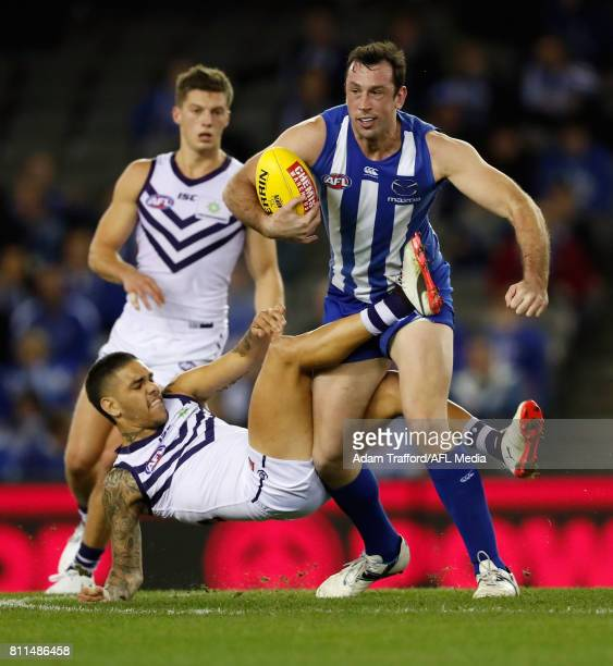 Todd Goldstein of the Kangaroos is tackled by Michael Walters of the Dockers during the 2017 AFL round 16 match between the North Melbourne Kangaroos...