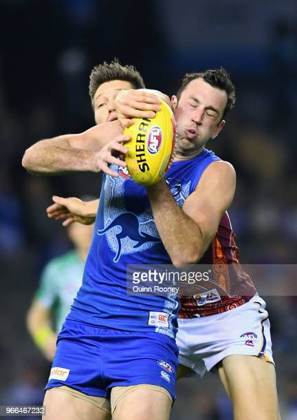 Todd Goldstein of the Kangaroos marks infront of Stefan Martin of the Lions during the round 11 AFL match between the North Melbourne Kangaroos and...