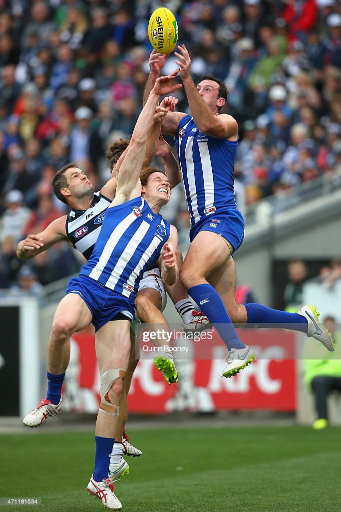 Todd Goldstein of the Kangaroos marks over the top of Jared Rivers of the Cats and Ben Brown of the Kangaroos during the round four AFL match between the Geelong Cats and the North Melbourne Kangaroos at Simonds Stadium on April 26, 2015 in Geelong, Australia.