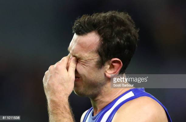 Todd Goldstein of the Kangaroos reacts after missing a shot at goal in the the final minute during the round 16 AFL match between the North Melbourne...