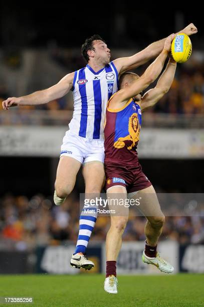 Todd Goldstein of the kangaroos spoils the mark of Matt Maguire of the Lions during the round 16 AFL match between the Brisbane Lions and the North...