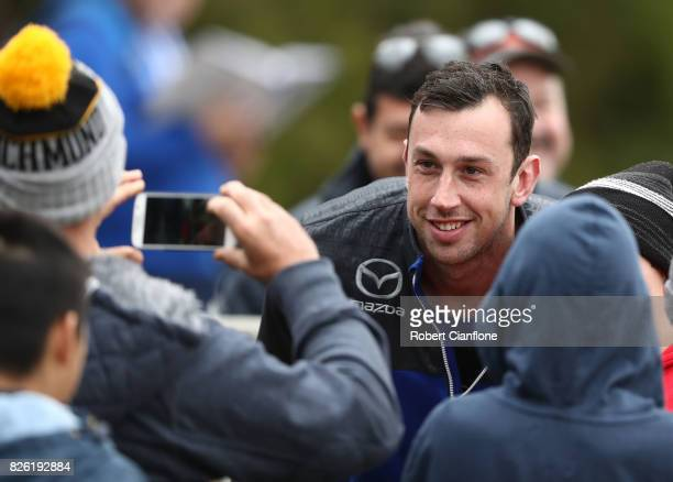 Todd Goldstein of the Kangaroos takes a photo with fans during a North Melbourne Kangaroos AFL training session at Arden Street Ground on August 4...