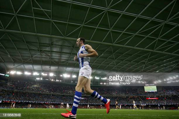 Todd Goldstein of the Kangaroos tests his injured ankle during the round 10 AFL match between the Essendon Bombers and the North Melbourne Kangaroos...