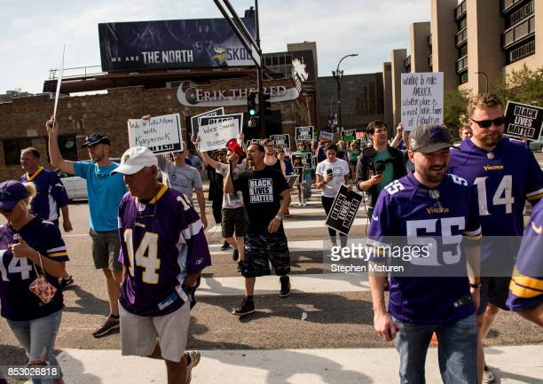 Todd Gramenz of Black Lives Matter St Paul leads a march of protestors outside a game betweenthe Minnesota Vikings and Tampa Bay Buccaneers on...