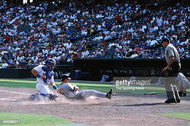 Todd Greene of the Texas Rangers attempts to tag out Mark Loretta of the Houston Astros at The Ballpark in Arlington on September 2 2002 in Arlington...