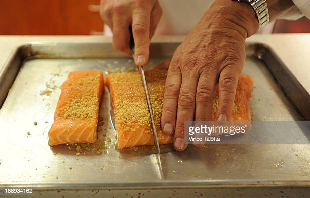 Todd Guerrin BC chef in the test kitchen cooking Maple Cured Salmon dish that he makes frequently for the fancy people who ride the rocky mountain...
