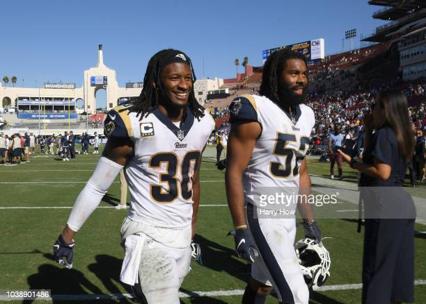 Todd Gurley and Ramik Wilson of the Los Angeles Rams smile as they leave the field after a 3523 win over the Los Angeles Chargers at Los Angeles...
