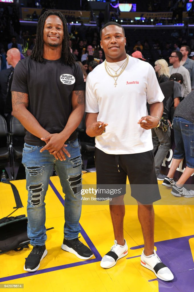 Todd Gurley (L) attends a basketball game between the Los Angeles Lakers and the San Antonio Spurs at Staples Center on April 4, 2018 in Los Angeles, California.
