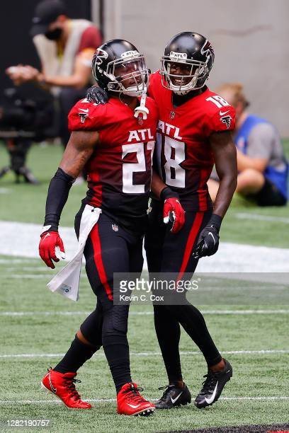 Todd Gurley II of the Atlanta Falcons is congratulated by Calvin Ridley after a 10-yard rushing touchdown against the Detroit Lions during the second...