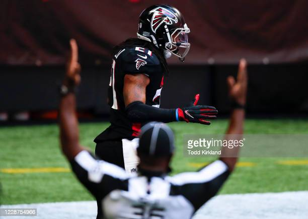 Todd Gurley II of the Atlanta Falcons reacts after scoring a touchdown during the second half of an NFL game against the Chicago Bears at...