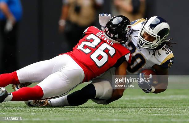 Todd Gurley II of the Los Angeles Rams is tackled by Isaiah Oliver of the Atlanta Falcons in the first half at MercedesBenz Stadium on October 20...