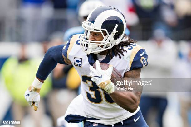 Todd Gurley II of the Los Angeles Rams runs the ball during a game against the Tennessee Titans at Nissan Stadium on December 24 2017 in Nashville...