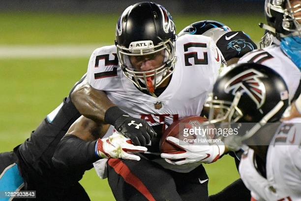 Todd Gurley of the Atlanta Falcons runs against the Carolina Panthers during the first quarter at Bank of America Stadium on October 29, 2020 in...