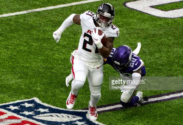 Todd Gurley of the Atlanta Falcons runs with the ball in the first quarter of the game against the Minnesota Vikings at U.S. Bank Stadium on October...