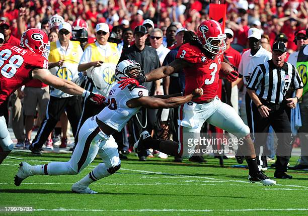 Todd Gurley of the Georgia Bulldogs carries the ball against T J Gurley of the South Carolina Gamecocks at Sanford Stadium on September 7 2013 in...