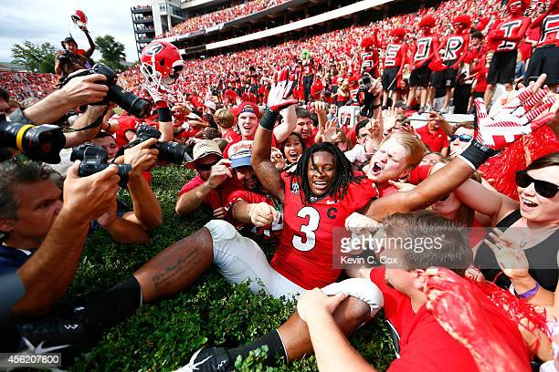 Todd Gurley of the Georgia Bulldogs celebrates their 35-32 win over the Tennessee Volunteers at Sanford Stadium on September 27, 2014 in Athens,...