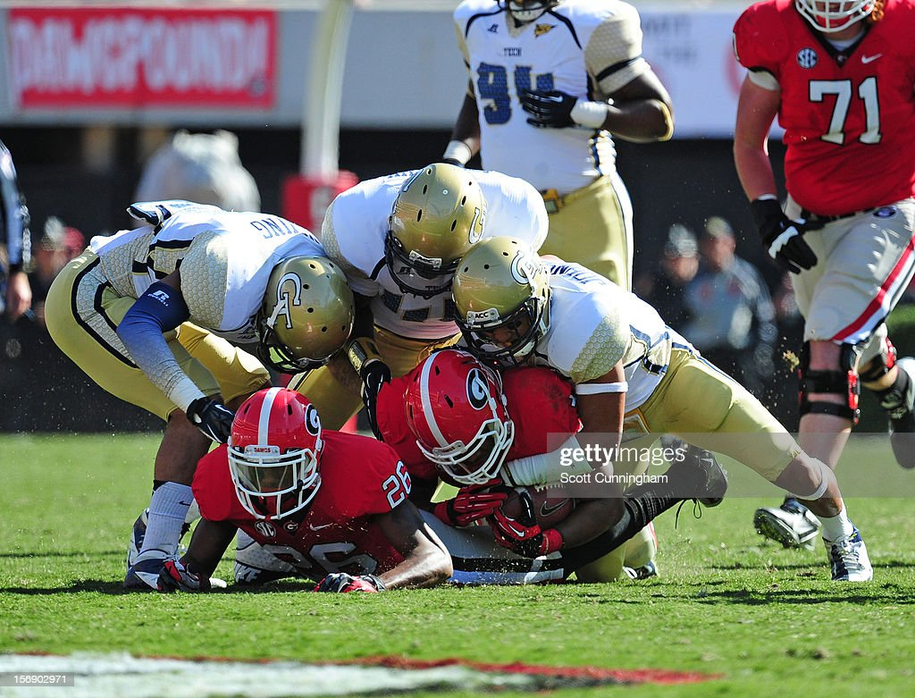 Todd Gurley #3 of the Georgia Bulldogs is tackled by Isaiah Johnson #1 of the Georgia Tech Yellow Jackets at Sanford Stadium on November 24, 2012 in Athens, Georgia.