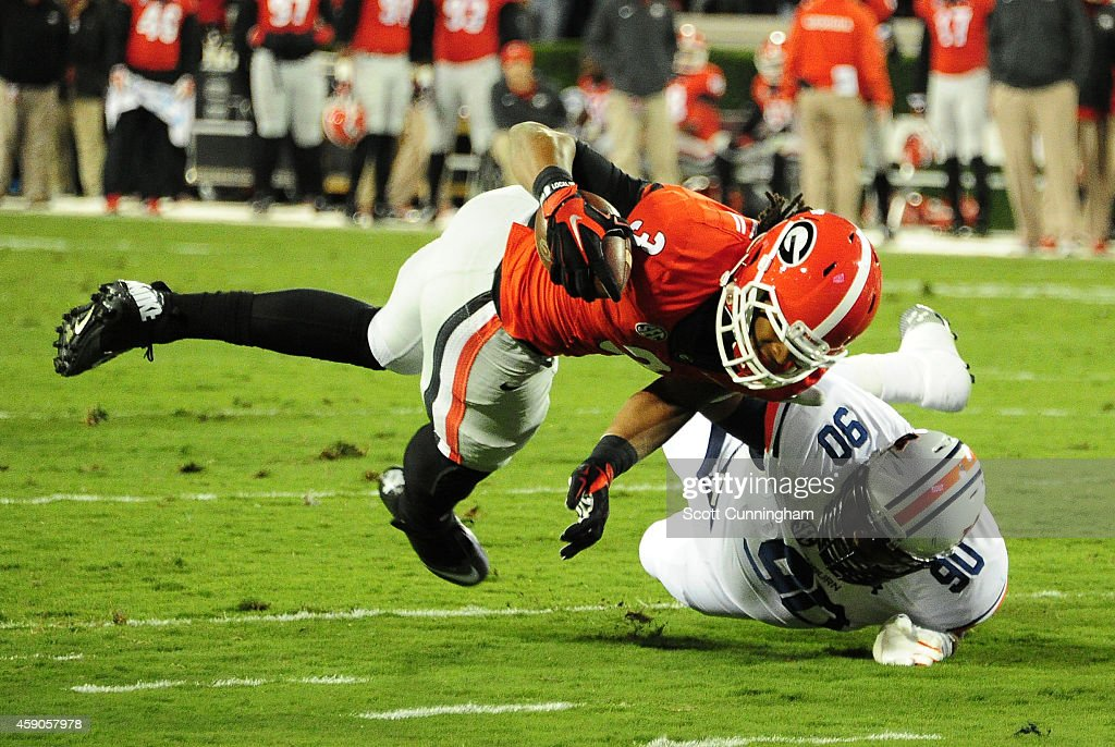 Todd Gurley #3 of the Georgia Bulldogs is upended by Gabe Wright #90 of the Auburn Tigers at Sanford Stadium on November 15, 2014 in Athens, Georgia.