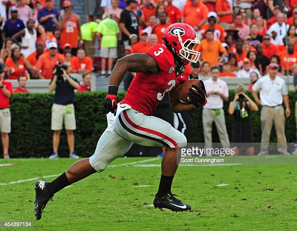 Todd Gurley of the Georgia Bulldogs returns a secondquarter kickoff for a 100yard touchdown against the Clemson Tigers at Sanford Stadium on August...