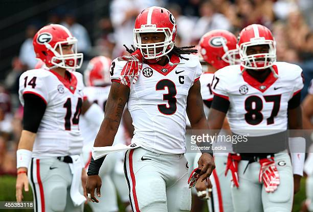 Todd Gurley of the Georgia Bulldogs runs onto the field after a weather delay before their game against the South Carolina Gamecocks at WilliamsBrice...