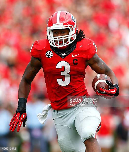 Todd Gurley of the Georgia Bulldogs rushes against the Tennessee Volunteers at Sanford Stadium on September 27 2014 in Athens Georgia