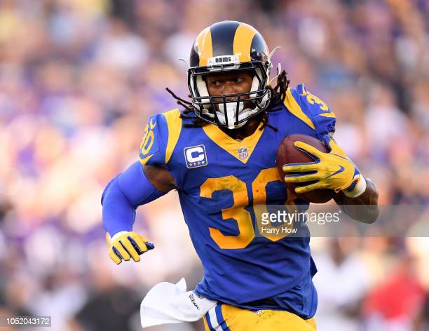 Todd Gurley of the Los Angeles Rams carries the ball against the Minnesota Vikings at Los Angeles Memorial Coliseum on September 27, 2018 in Los...