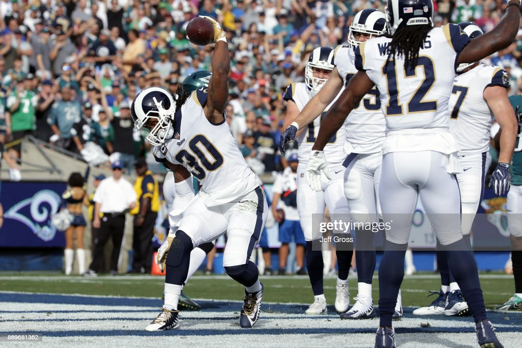 Todd Gurley #30 of the Los Angeles Rams celebrates after scoring the first touchdown of the game during the first quarter of the game against the Philadelphia Eagles at the Los Angeles Memorial Coliseum on December 10, 2017 in Los Angeles, California.