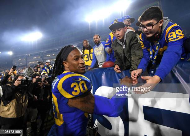 Todd Gurley of the Los Angeles Rams celebrates with fans after defeating the Dallas Cowboys in the NFC Divisional Playoff game at Los Angeles...