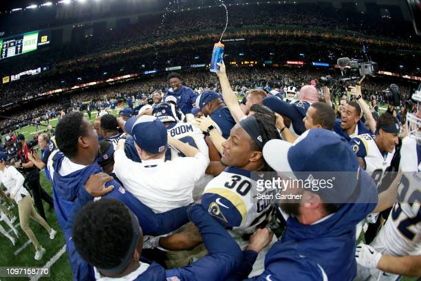 Todd Gurley of the Los Angeles Rams celebrates with his teammates after defeating the New Orleans Saints in the NFC Championship game at the...