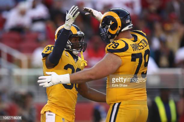 Todd Gurley of the Los Angeles Rams celebrates with Rob Havenstein after a touchdown against the San Francisco 49ers during their NFL game at Levi's...