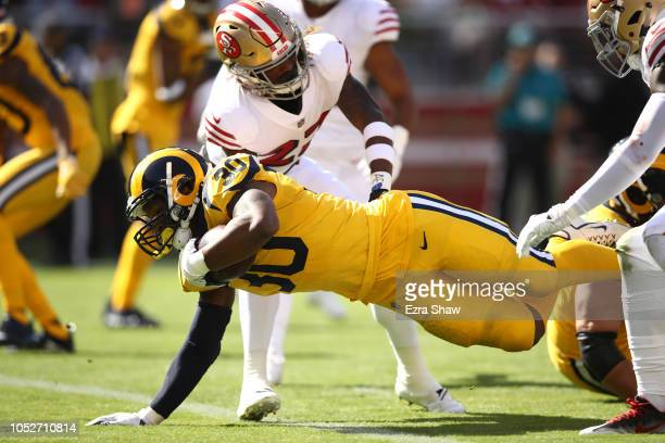 Todd Gurley of the Los Angeles Rams dives for a touchdown against the San Francisco 49ers during their NFL game at Levi's Stadium on October 21 2018...