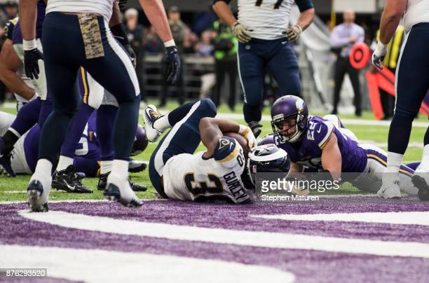 Todd Gurley of the Los Angeles Rams falls into the end zone with the ball for a touchdown in the first quarter of the game against the Minnesota...