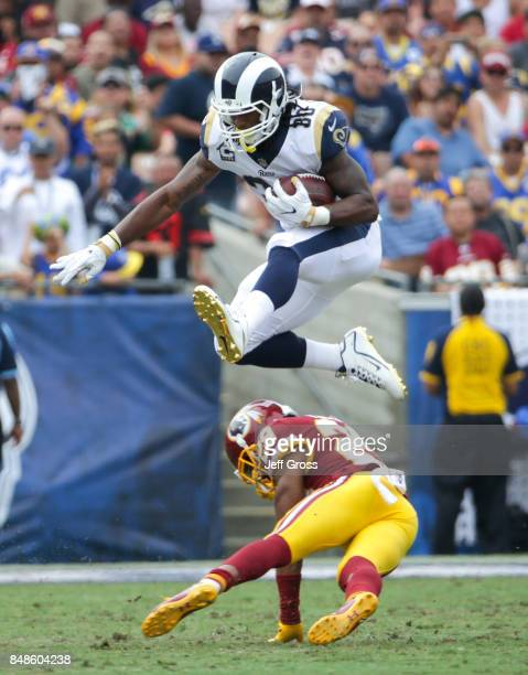 Todd Gurley of the Los Angeles Rams leaps over Kendall Fuller of the Washington Redskins at Los Angeles Memorial Coliseum on September 17, 2017 in...