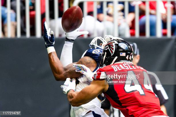 Todd Gurley of the Los Angeles Rams makes a reception for a touchdown in front of Vic Beasley of the Atlanta Falcons during the first half of a game...