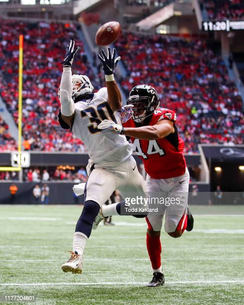 Todd Gurley of the Los Angeles Rams makes the reception for a touchdown as Vic Beasley of the Atlanta Falcons defends in the first half of an NFL...