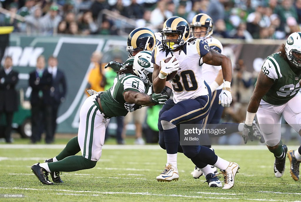 Todd Gurley #30 of the Los Angeles Rams runs against Julian Stanford #51 of the New York Jets at MetLife Stadium on November 13, 2016 in East Rutherford, New Jersey.