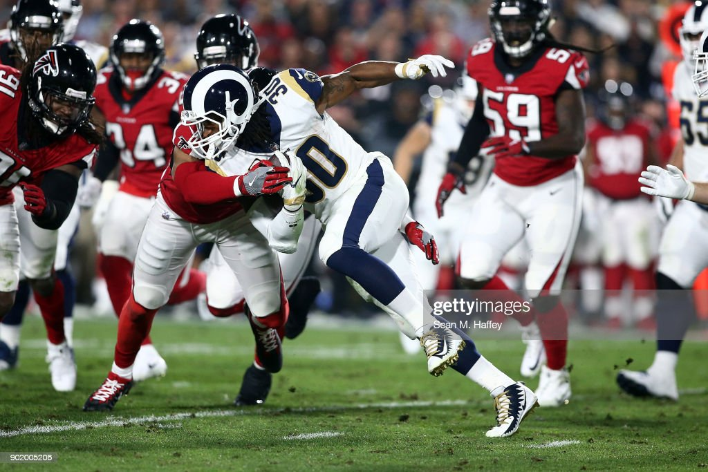 Todd Gurley #30 of the Los Angeles Rams runs the ball down field during the NFC Wild Card Playoff Game against the Atlanta Falcons at the Los Angeles Coliseum on January 6, 2018 in Los Angeles, California.