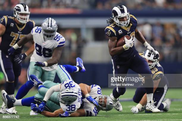 Todd Gurley of the Los Angeles Rams runs the ball past Jeff Heath and Brian Price of the Dallas Cowboys in the third quarter at AT&T Stadium on...