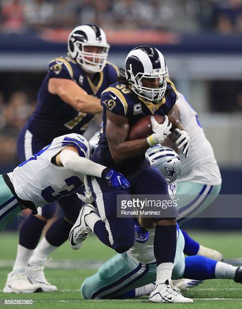 Todd Gurley of the Los Angeles Rams runs the ball past Jeff Heath and Brian Price of the Dallas Cowboys in the third quarter at ATT Stadium on...