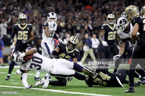Todd Gurley of the Los Angeles Rams scores a touchdown against the New Orleans Saints during the second quarter in the NFC Championship game at the...