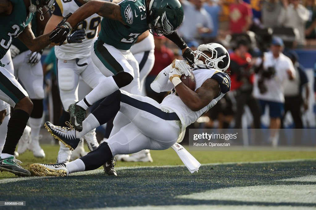 Todd Gurley #30 of the Los Angeles Rams scores the first touchdown of the game during the first quarter of the game against the Philadelphia Eagles at the Los Angeles Memorial Coliseum on December 10, 2017 in Los Angeles, California.