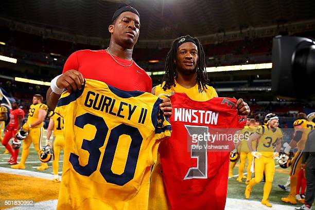 Todd Gurley of the St Louis Rams and Jameis Winston of the Tampa Bay Buccaneers pose after exchanging jerseys after a game at the Edward Jones Dome...