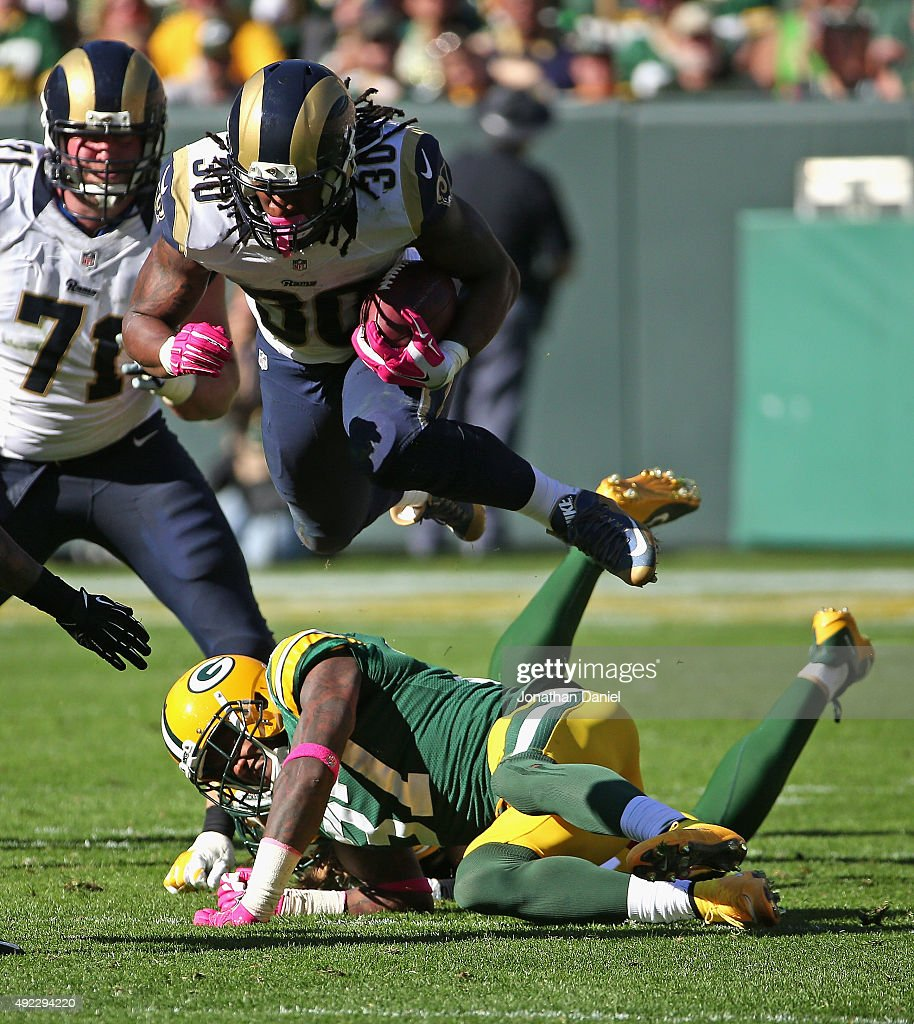 Todd Gurley #30 of the St. Louis Rams leaps over Sam Shields #37 and Clay Matthews #52 of the Green Bay Packers at Lambeau Field on October 11, 2015 in Green Bay, Wisconsin. The Packers defeated the Rams 24-10.
