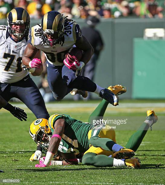 Todd Gurley of the St Louis Rams leaps over Sam Shields and Clay Matthews of the Green Bay Packers at Lambeau Field on October 11 2015 in Green Bay...