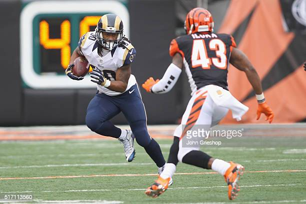 Todd Gurley of the St Louis Rams runs the football upfield against George Iloka of the Cincinnati Bengals during their game at Paul Brown Stadium on...