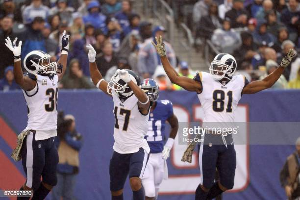Todd Gurley Robert Woods and Gerald Everett of the Los Angeles Rams celebrate after Woods scored a touchdown in the first half against the New York...
